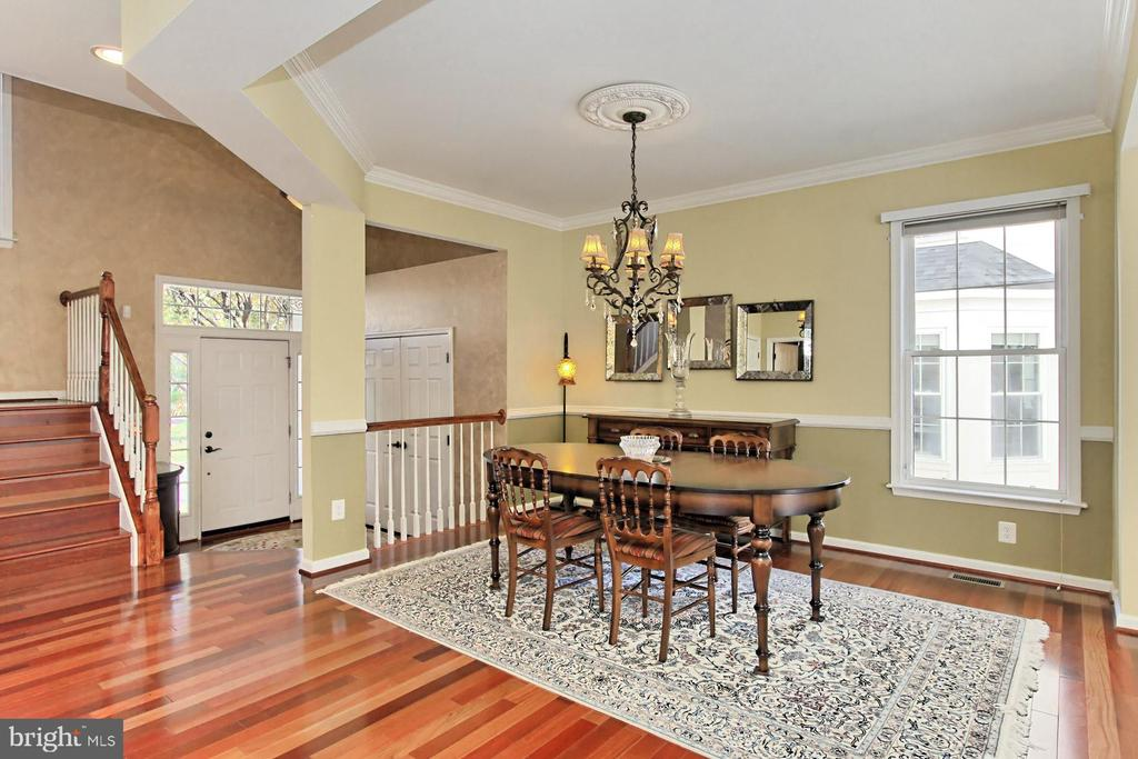 Elegant Dining Room with decorative moldings. - 47525 SAULTY DR, STERLING
