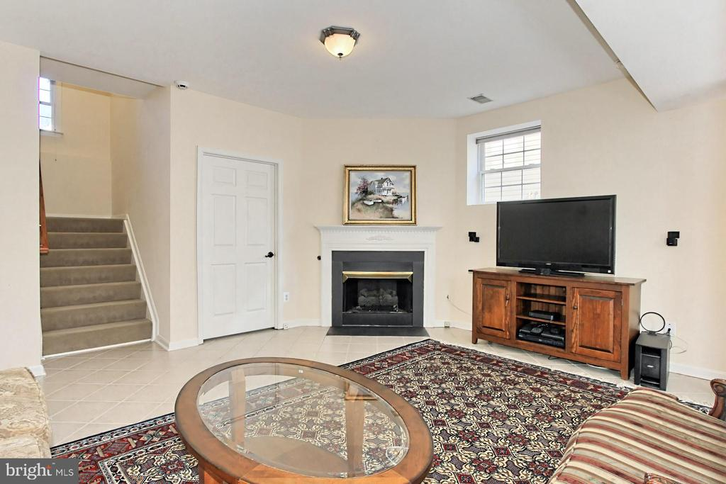 One of two staircases to access the main level. - 47525 SAULTY DR, STERLING