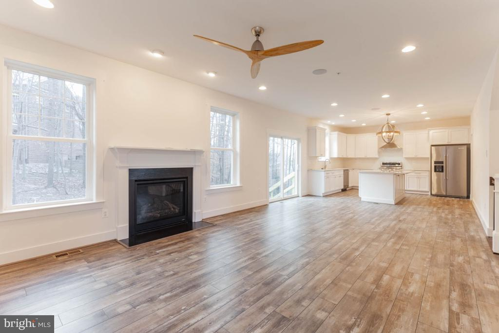 Family room opens to kitchen. - 6746 ACCIPITER (LOT 192) DR, NEW MARKET