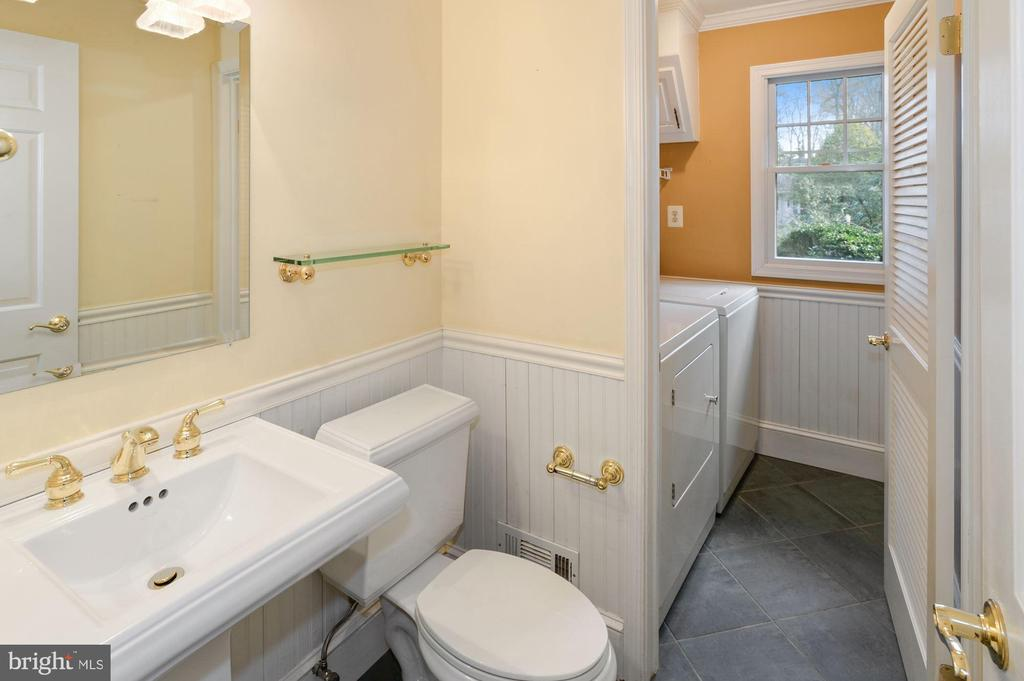 Powder room with Laundry room off the kitchen - 2605 SOAPSTONE DR, RESTON