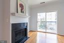 Gas fireplace with mantel warms up winter nights - 11326 ARISTOTLE DR #4-303, FAIRFAX