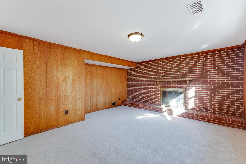 Cozy family room with wood burning fireplace - 10300 WOOD RD, FAIRFAX