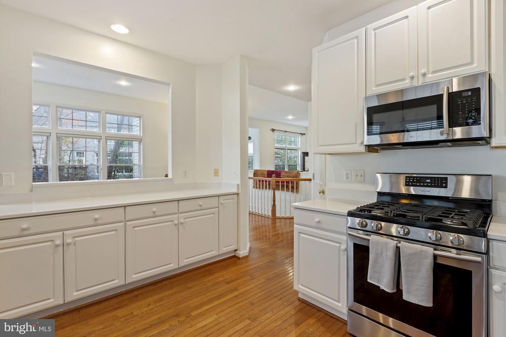 white kitchen with new quartz countertops - 20660 SHOAL PL, STERLING