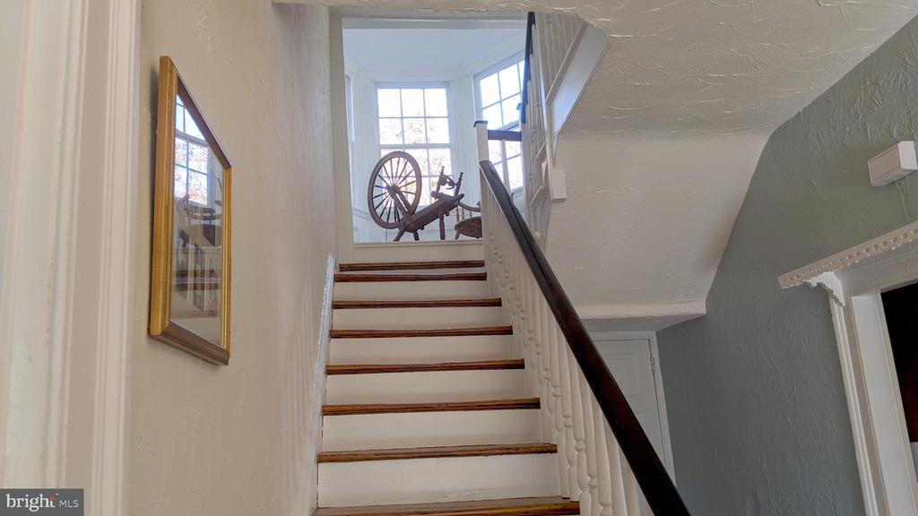 stairway with view of alcove - 4343 39TH ST NW, WASHINGTON