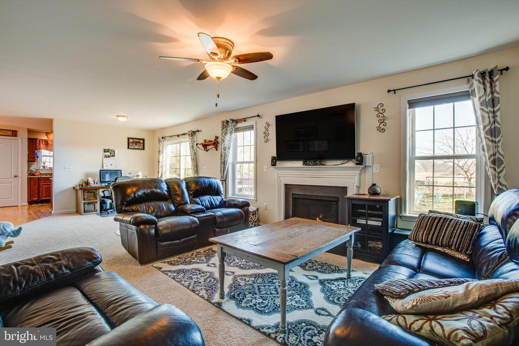 Light and bright family room with fireplace - 628 LATANE DR, COLONIAL BEACH