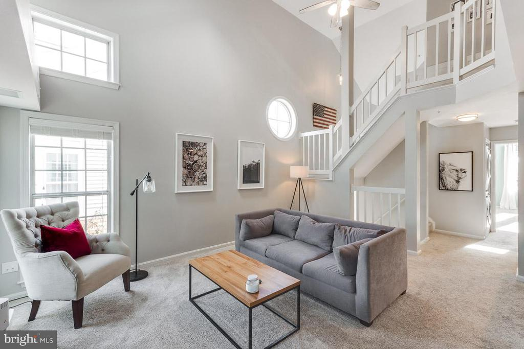Living room with stairs to upper level - 6922 ELLINGHAM CIR #122, ALEXANDRIA