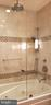 Beautiful marble/mosaic above jacuzzi tub - 11503 MAPLE RIDGE RD, RESTON