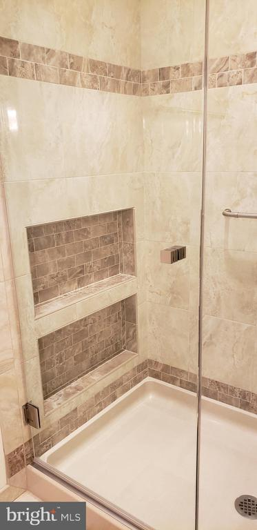 Tiled niches with custom glass shower doors - 11503 MAPLE RIDGE RD, RESTON