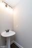 Main floor half bath. - 6789 ACCIPITER DR, NEW MARKET