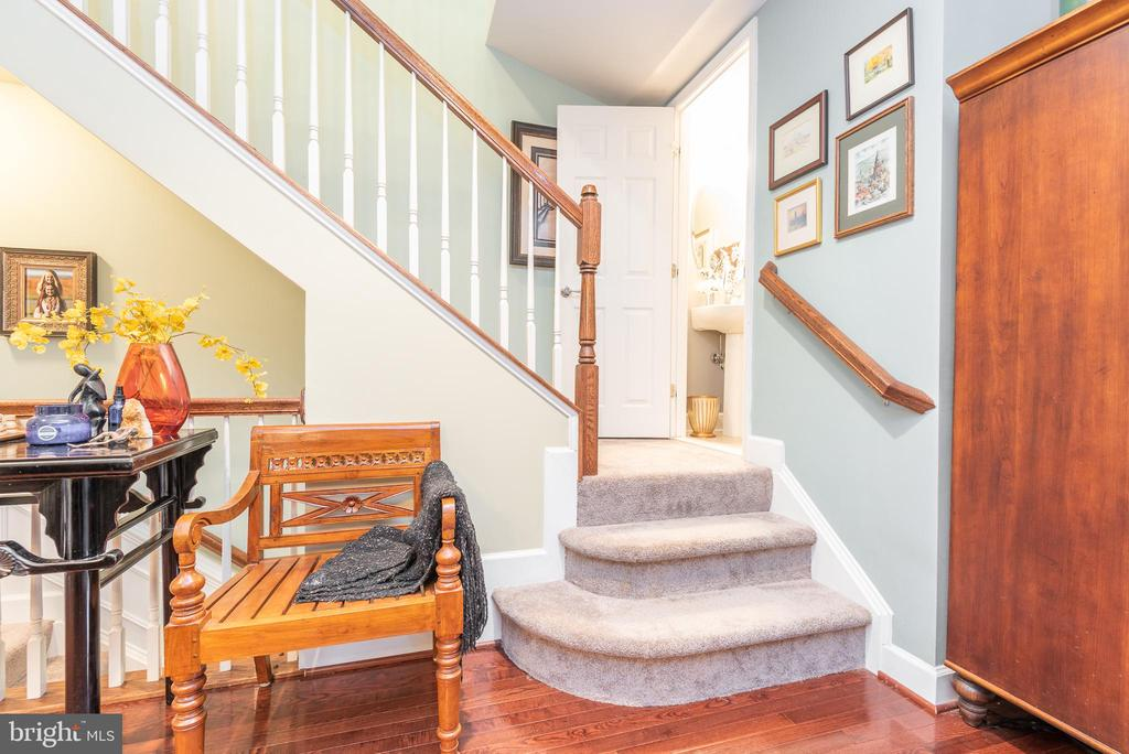 Stairs leading to half bath and upper level - 194 STAR VIOLET TER SE, LEESBURG