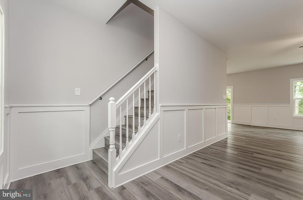 Stairs to upper level - 986 LOWER CLUBHOUSE DR, HARPERS FERRY