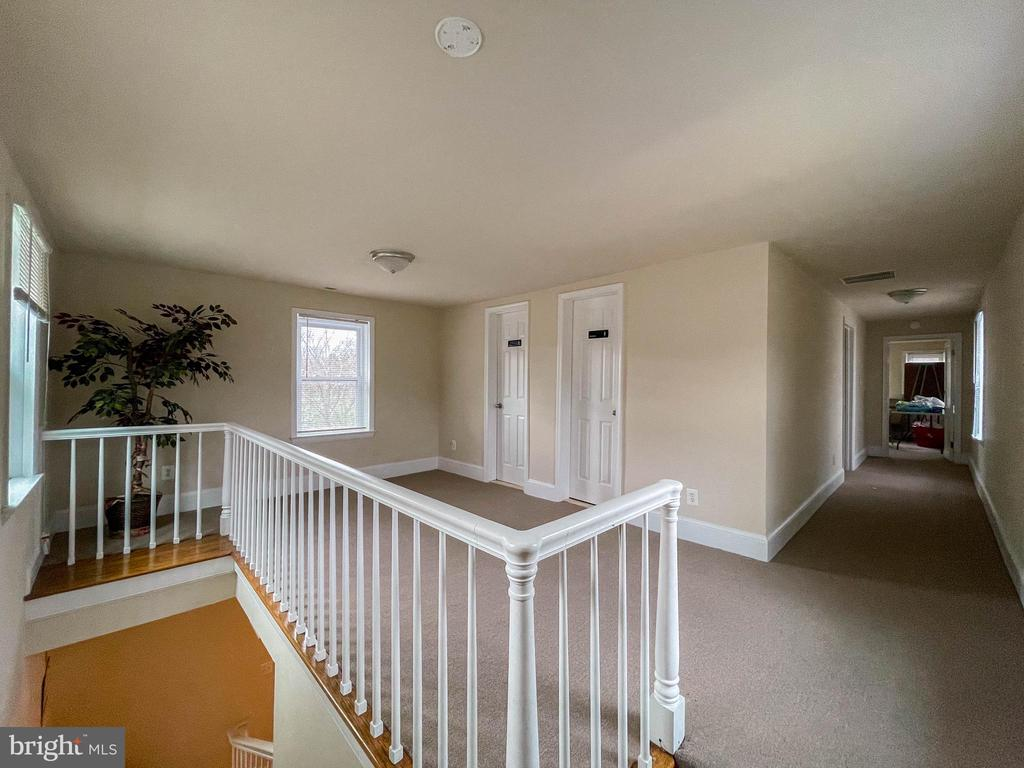 View from the top of the stairwell. 2 BR & 2 Bath - 7708 BROOKLYN BRIDGE RD, LAUREL
