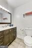 Bathroom vanity, toilet, and tile floor in 2020 - 403 N BEAUREGARD ST #304, ALEXANDRIA