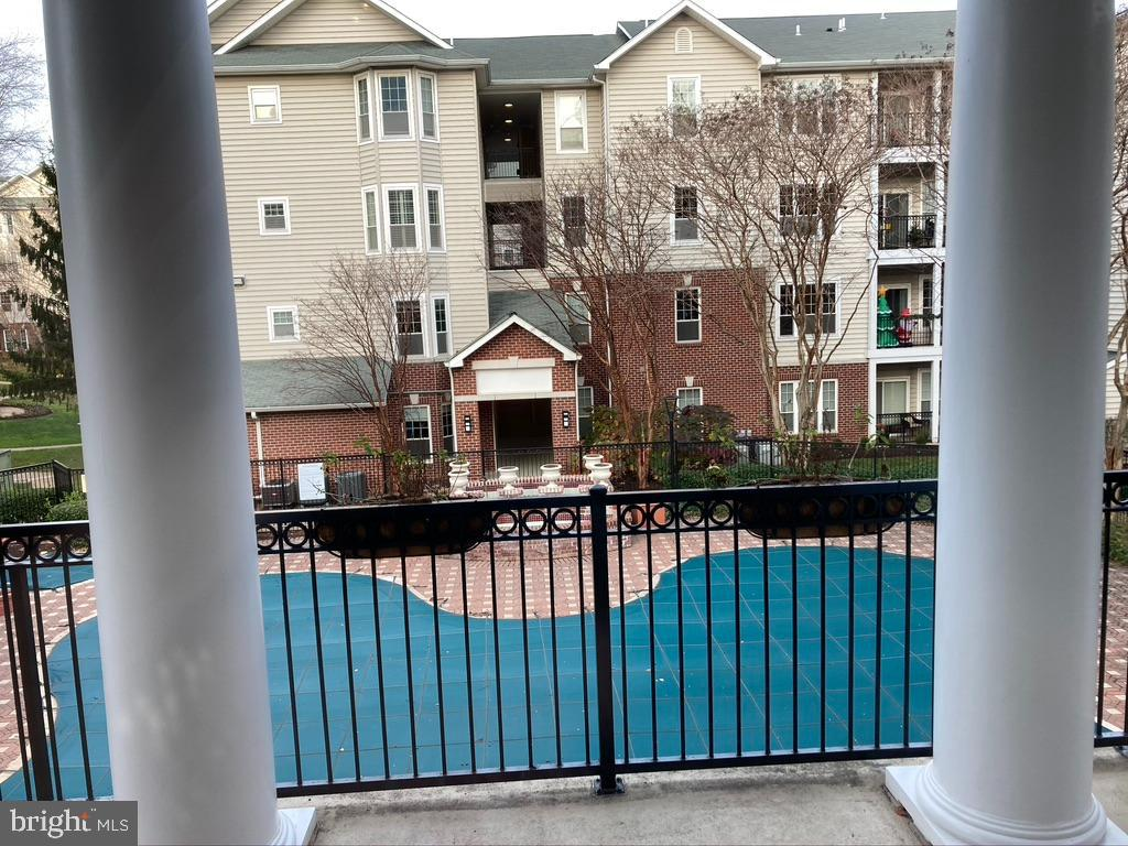 Community Pool view from Clubhouse - 1581 SPRING GATE DR #5404, MCLEAN