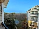 Balcony View looks down at Basketball Courts - 1581 SPRING GATE DR #5404, MCLEAN
