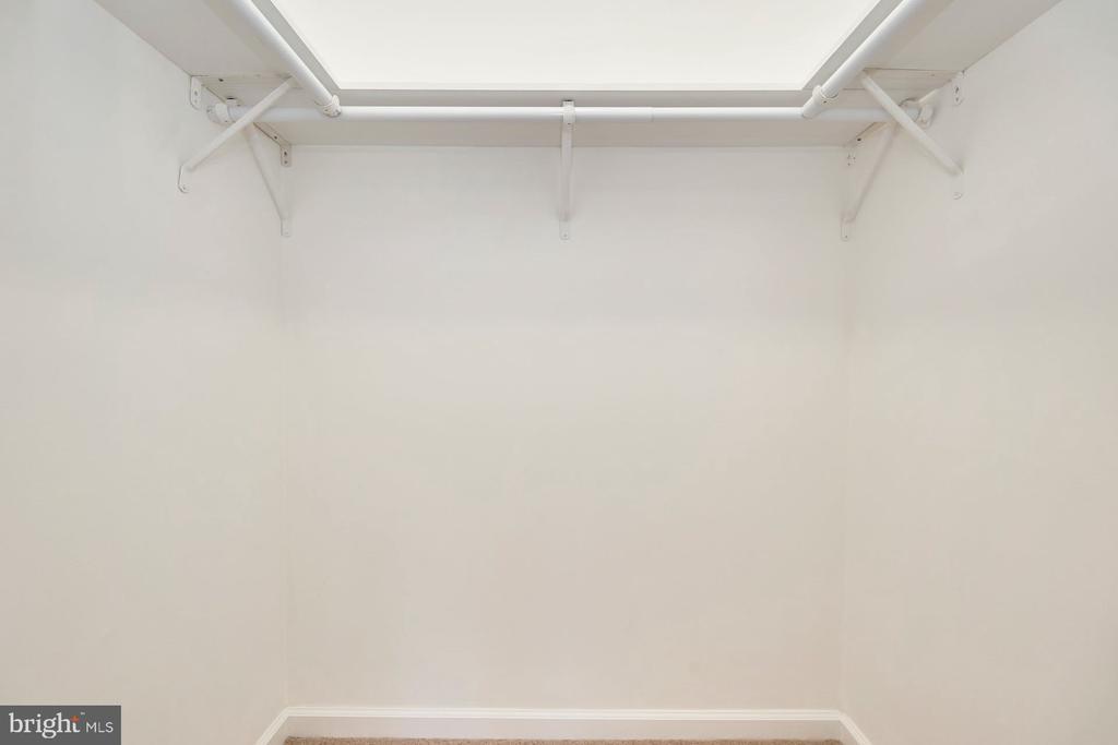 Walk-in closet in primary bedroom - 11817 COOPERS CT, RESTON