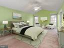 Photo staging shows off the size of bedroom - 13057 CHAMPLAIN DR, MANASSAS