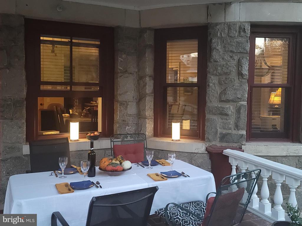 Summer evening on the patio - 9610 DEWITT DR #PH101, SILVER SPRING
