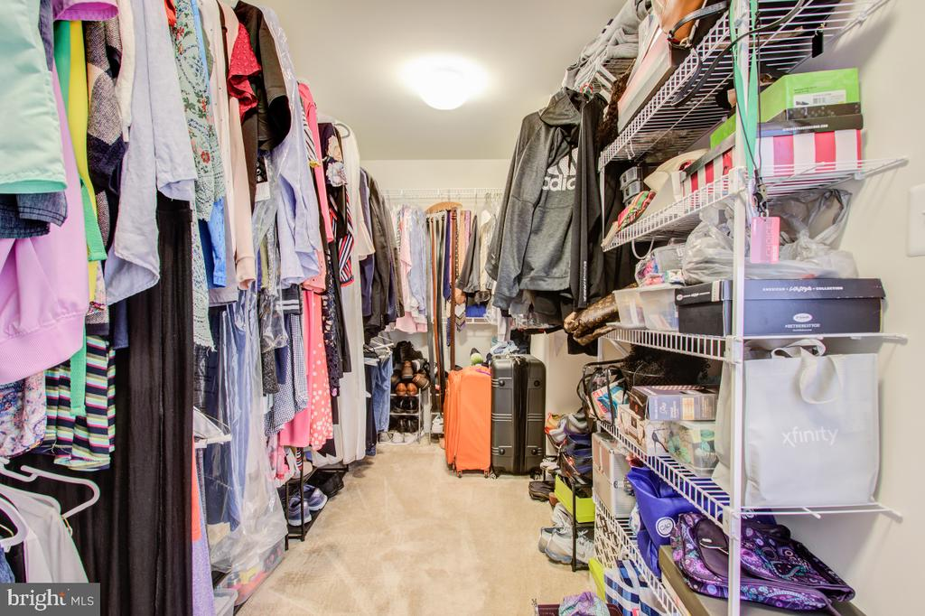 Expansive walk in closet in the primary bedroom. - 5502 HAWK RIDGE RD, FREDERICK