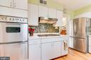 New backsplash, refrigerator and stove top - 10702 STONEYHILL DR, SILVER SPRING