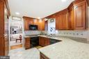 Cherry cabinets with subzero refrigerator - 5707 ROSSMORE DR, BETHESDA