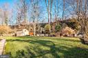 Spacious backyard with extensive hardscape & shed - 5707 ROSSMORE DR, BETHESDA