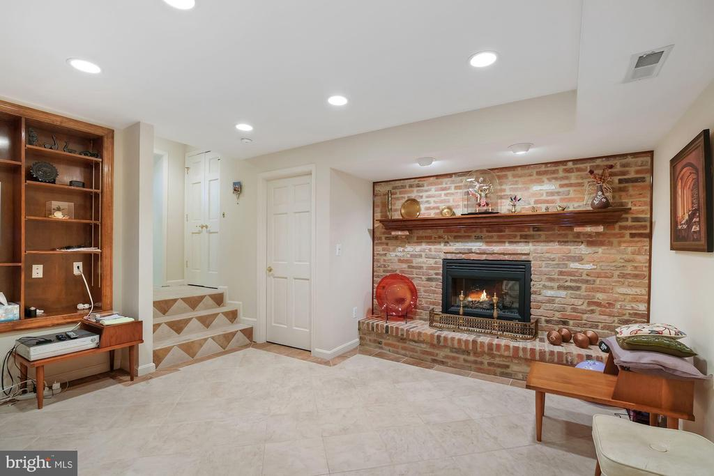 Exercise room with #5 fireplace - 5707 ROSSMORE DR, BETHESDA