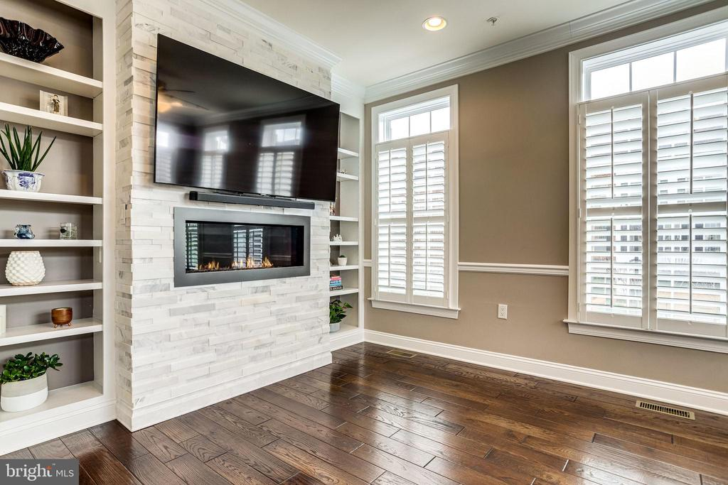 Built in shelving surrounds  fireplace - 4349 4TH ST N, ARLINGTON