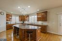 Spacious granite kitchen island - 41205 CANONGATE DR, LEESBURG