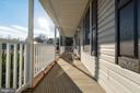 Front porch to sit and relax - 6109 SUNNY MEADOWS DR, FREDERICKSBURG