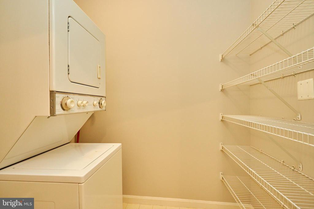 Laundry room with stacking washer/dryer - 19350 MAGNOLIA GROVE SQ #407, LEESBURG
