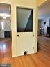 HALF/ FULLCLOSE DOOR TO BASEMENT WITH KITTY DOOR - 333 CARDINAL GLEN CIR, STERLING