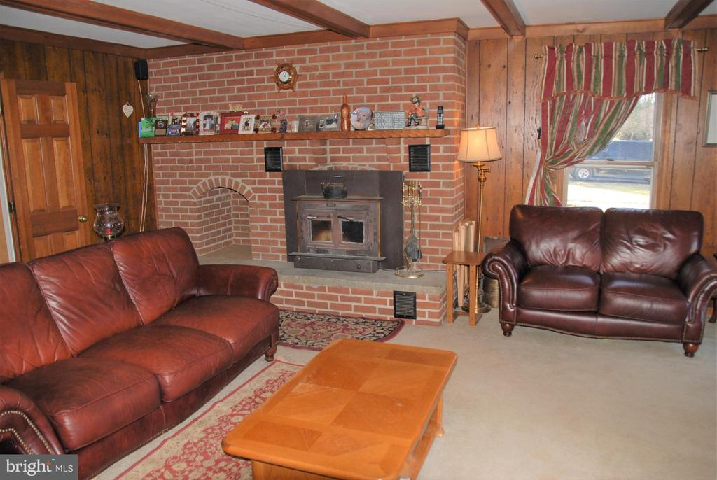 Living room with fireplace insert for cozy nights - 12138 HARPERS FERRY RD, PURCELLVILLE