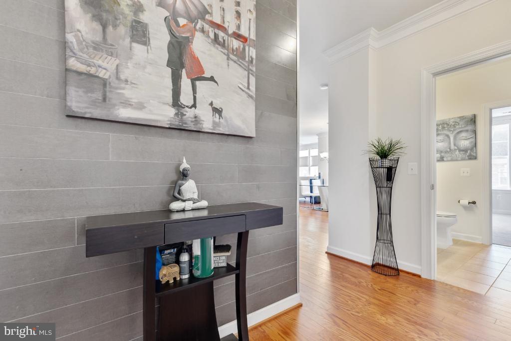 Custom accent wall in the foyer! - 3160 JOHN GLENN ST #308, HERNDON