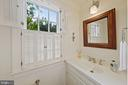 A quaint half bath is located just off the kitchen - 639 S SAINT ASAPH ST, ALEXANDRIA