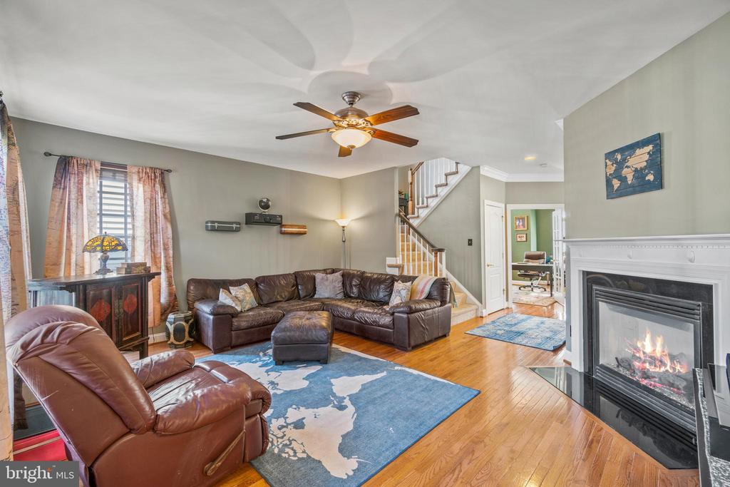 Family Room showing gas Fireplace - 11924 RICKETTS BATTERY DR, BRISTOW