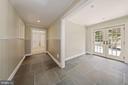 Lower level flagstone floor walkout to rear yard - 1901 ALLANWOOD PL, SILVER SPRING