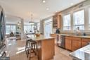 Kitchen with granite counters and tile floors - 11322 SCOTT PETERS CT, MANASSAS