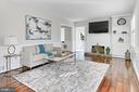 Bright, open living room with fireplace - 9401 OX RD, LORTON