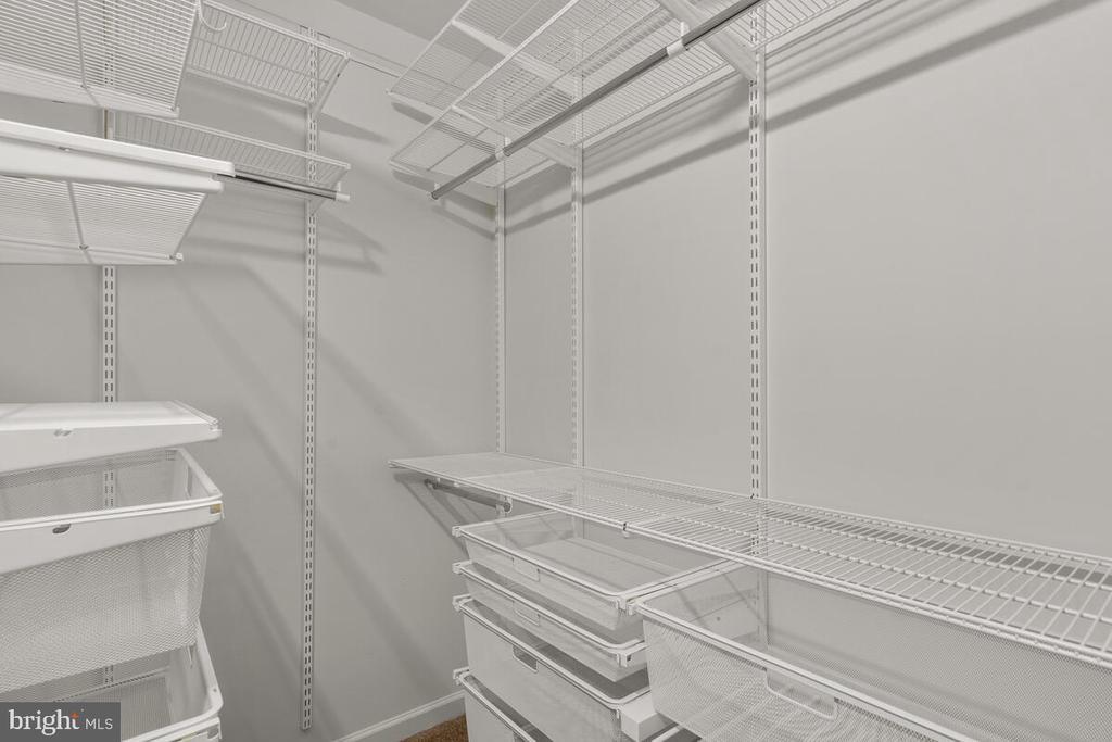 Elfa Shelving in Both Primary Bedroom Closets - 7839 RIVER ROCK WAY, COLUMBIA