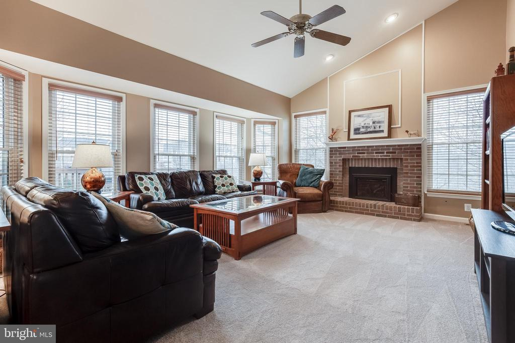 Open Family Room with Gas Fireplace - 609 MICHAEL PATRICK CT SE, LEESBURG