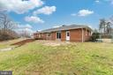 Rear of home with chain link fence - 9035 DAHLGREN RD, KING GEORGE