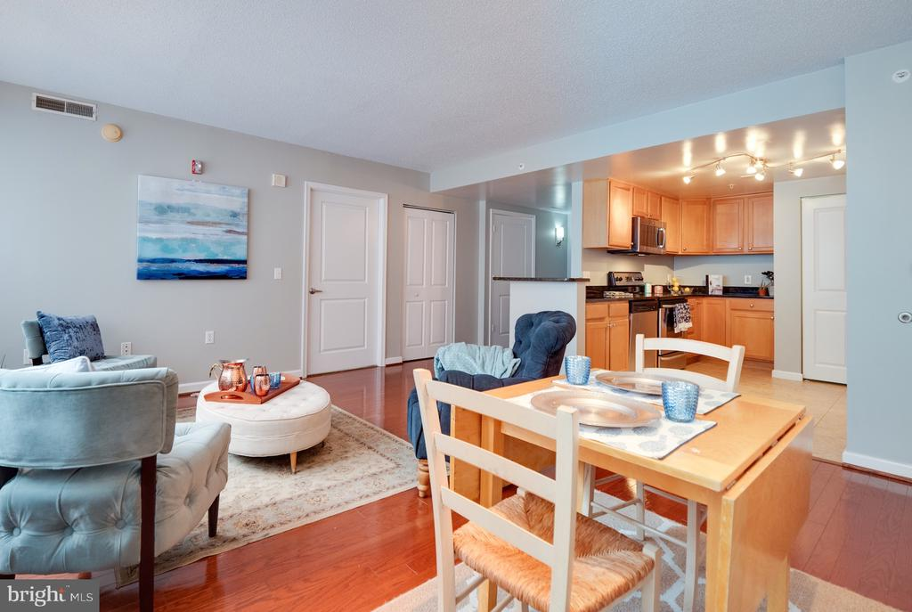 Dining/Living area opens to large kitchen - 880 N POLLARD ST #201, ARLINGTON