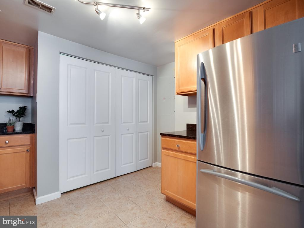 In unit washer and dryer.   Behind these doors. - 880 N POLLARD ST #201, ARLINGTON