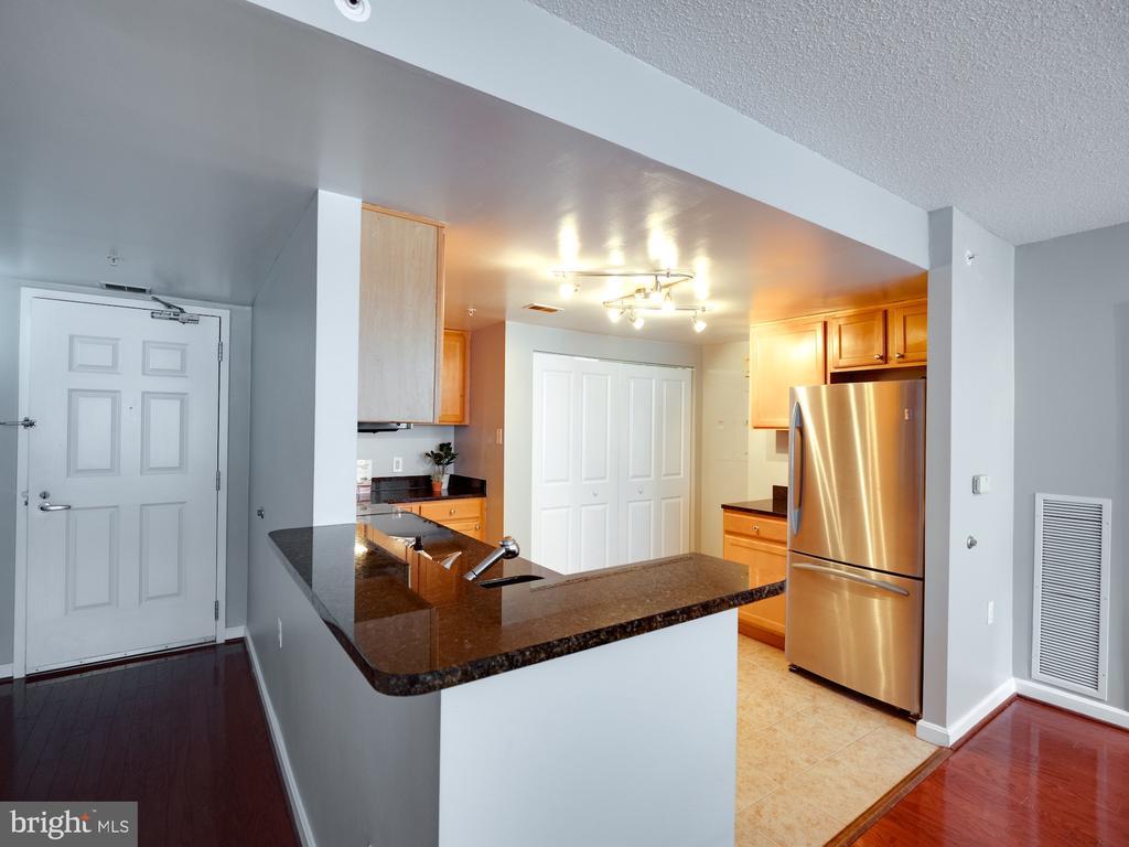 Kitchen overlooks living/dining area.   Entertain! - 880 N POLLARD ST #201, ARLINGTON