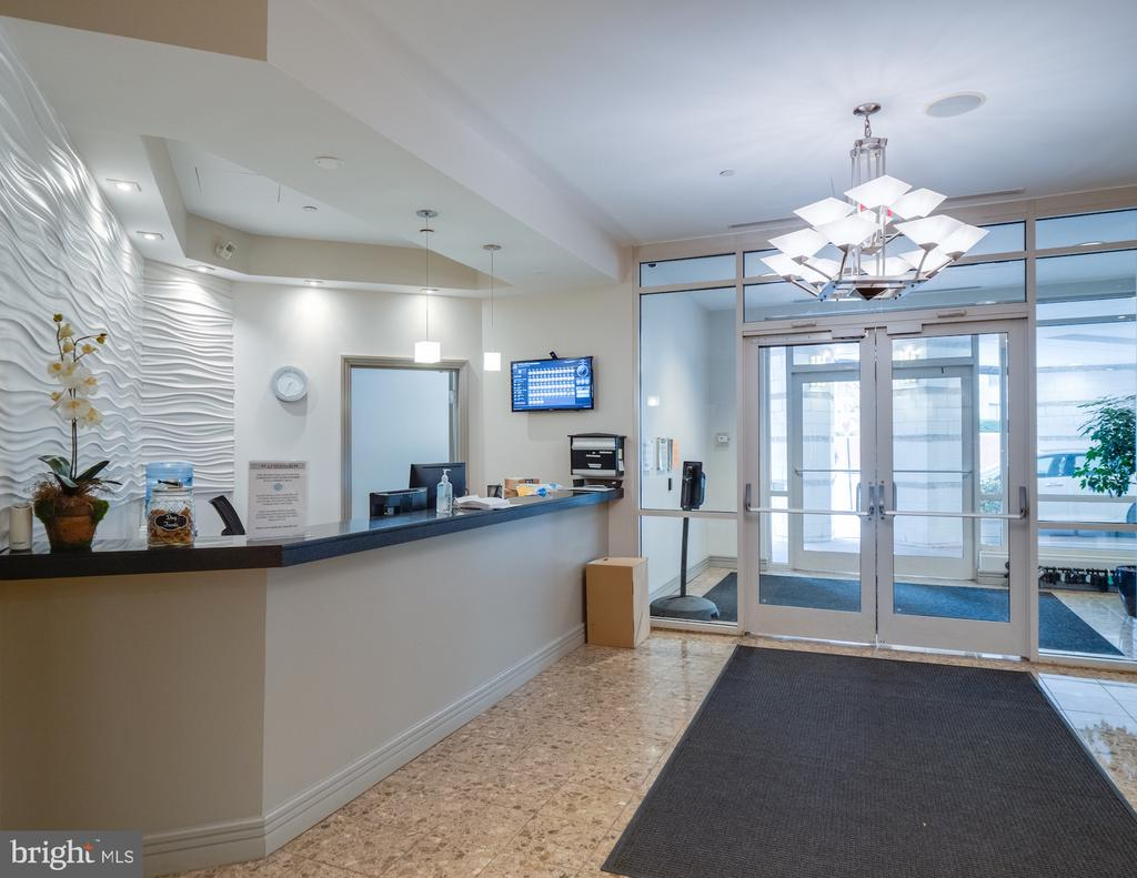 Concierge desk at entry.    Receive your packages. - 880 N POLLARD ST #201, ARLINGTON