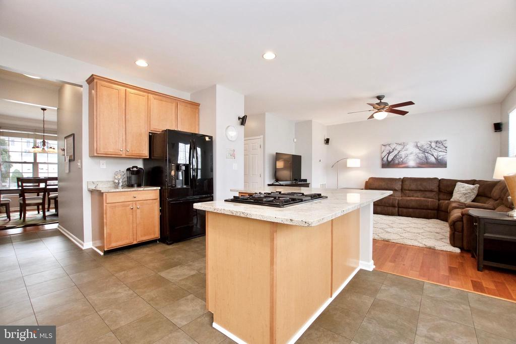Large kitchen has beautiful updated tile flooring - 42630 HARRIS ST, CHANTILLY