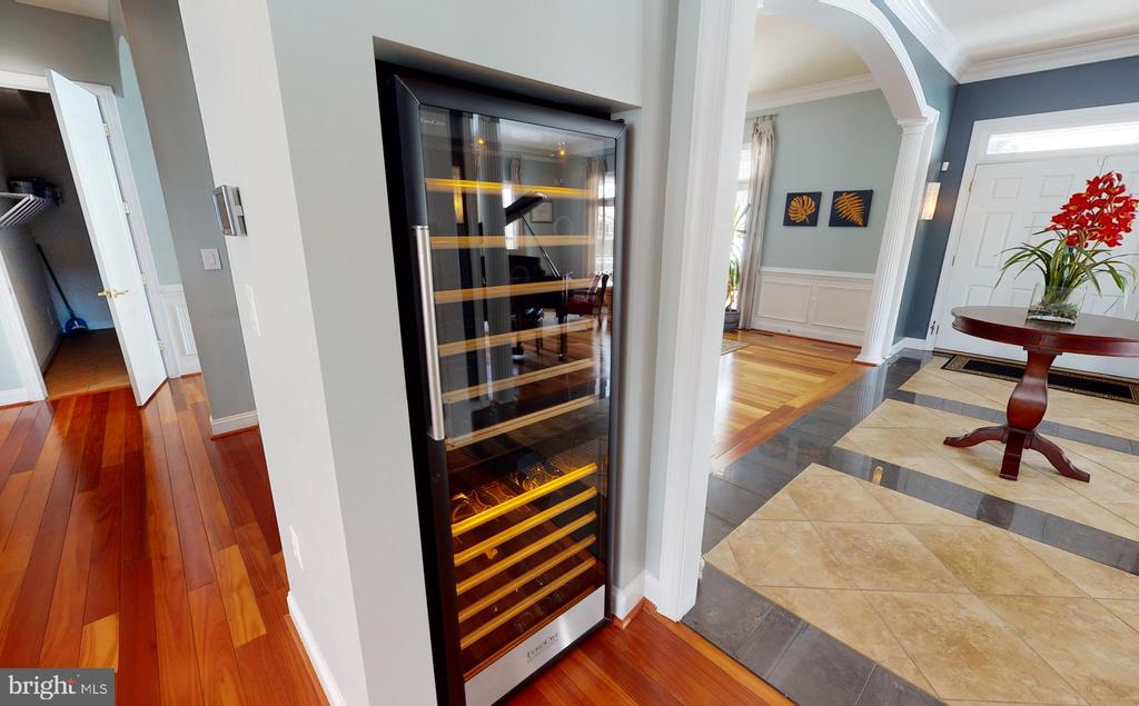 Wine fridge adjacent to the wet bar - 206 GREENHOW CT SE, LEESBURG