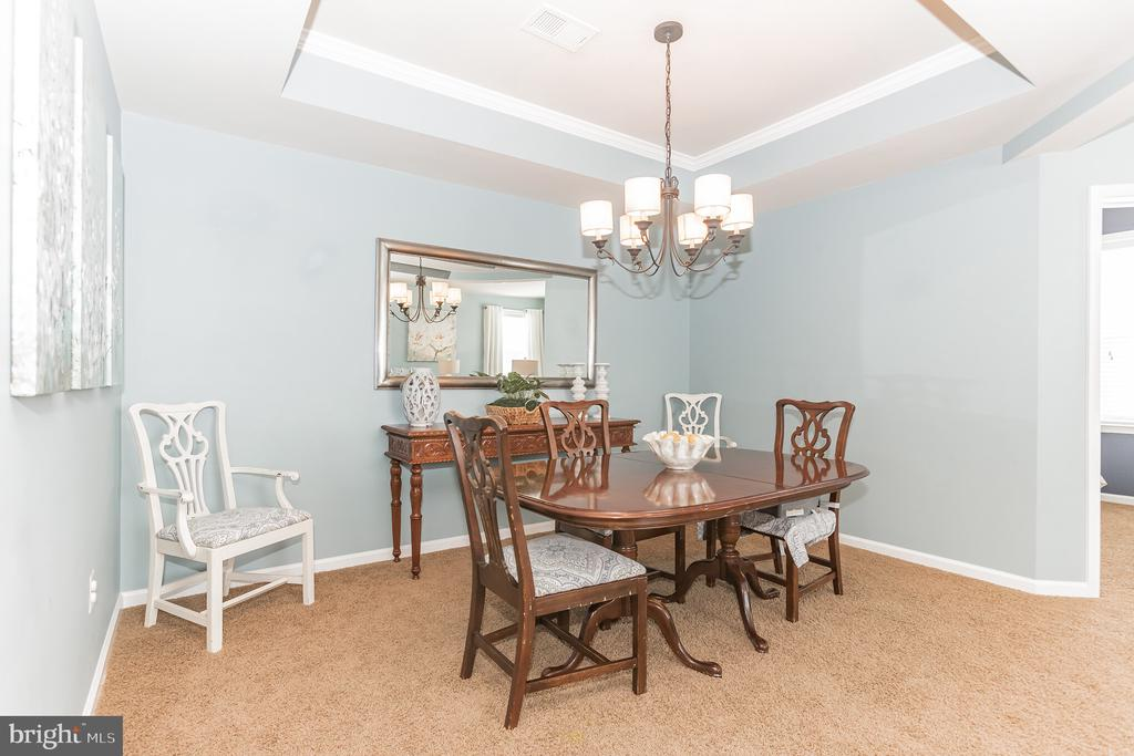 Dining room w coffered ceiling and nice lighting! - 22702 VERDE GATE TER, ASHBURN