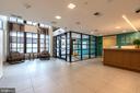 Lobby entrance w/ attended front desk - 1411 KEY BLVD #211, ARLINGTON